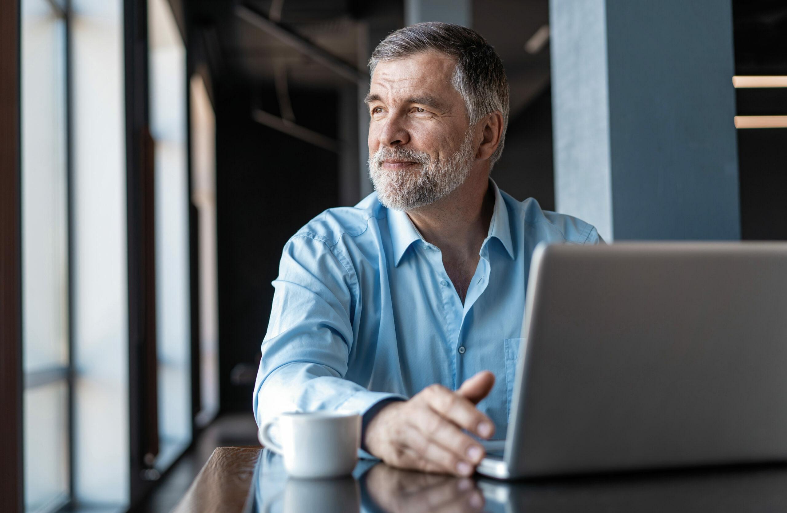 Elder gentleman on laptop