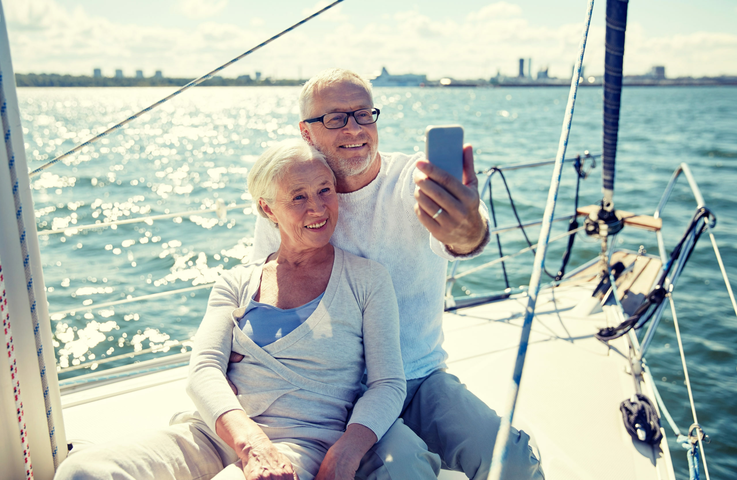 Retired couple taking a photo on boat