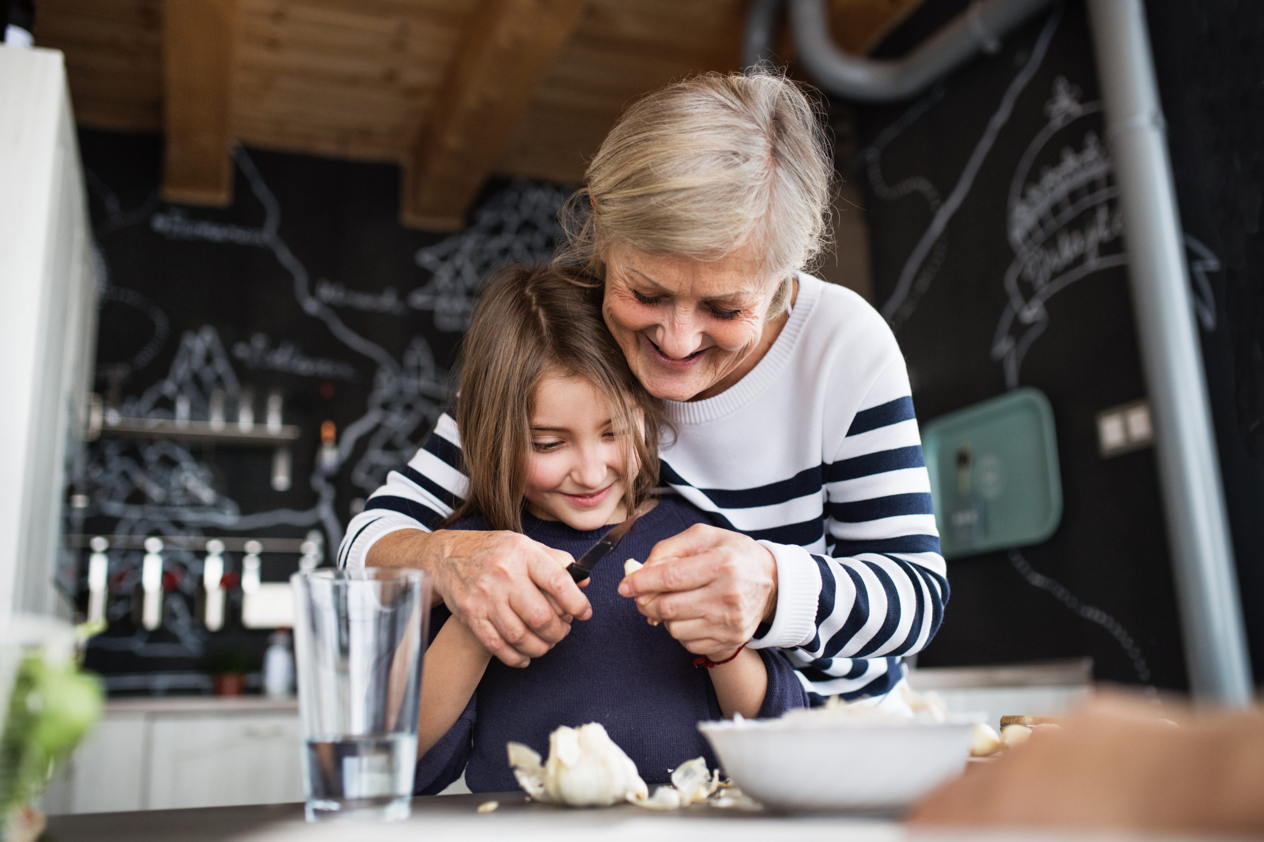 grandmother cooking with granddaughter